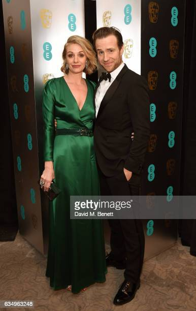 Elize du Toit and Rafe Spall attend the official after party dinner for the EE British Academy Film Awards at Grosvenor House on February 12 2017 in...