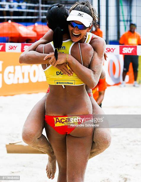 Elize Maia and Duda Lisboaof Brazil celebrate their victory after winning the golden medal match against Netherlands at Pajucara beach during day six...