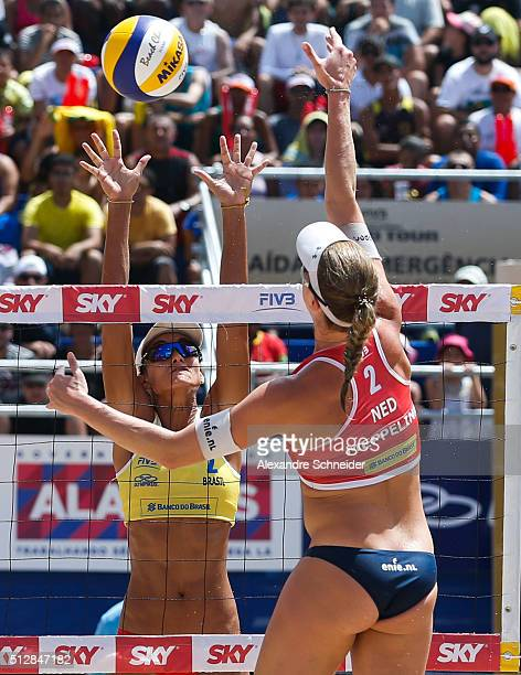 Elize Maia of Brazil blocks tha ball against Madeleine Meppelink during the golden medal match at Pajucara beach during day six of the FIVB Beach...
