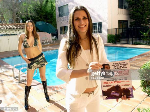 Elizebeth Hahn of Bad Girl productions holds her latest advertisement using Saddam Hussein to promote her Go Go Dancer and Stripper business....