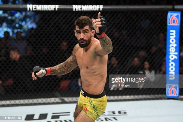 Elizeu dos Santos of Brazil reacts after submitting Curtis Millender in their welterweight bout during the UFC Fight Night event at Intrust Bank...