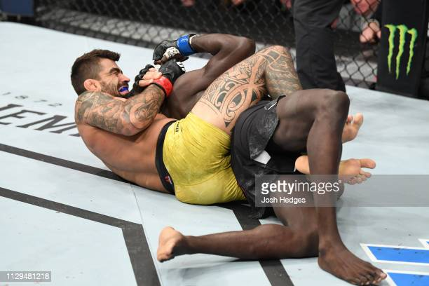 Elizeu dos Santos of Brazil submits Curtis Millender in their welterweight bout during the UFC Fight Night event at Intrust Bank Arena on March 9...