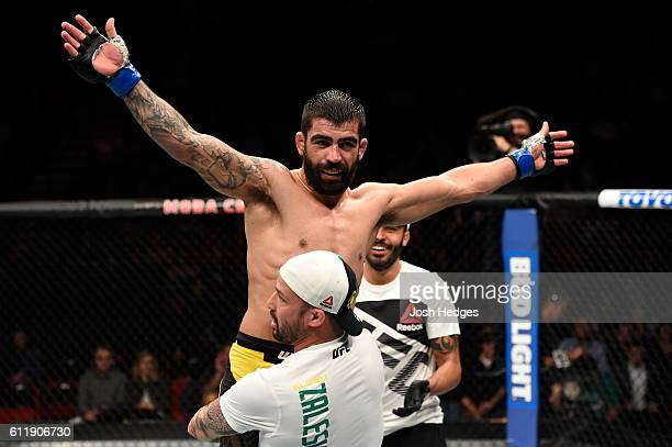 Elizeu Zaleski dos Santos of Brazil celebrates after defeating Keita Nakamura of Japan in their welterweight bout during the UFC Fight Night event at...