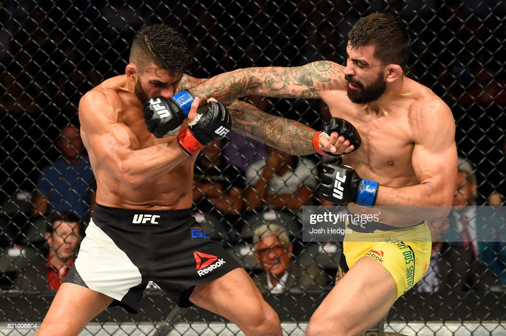 Elizeu Zaleski dos Santos of Brazil punches Lyman Good in their welterweight bout during the UFC Fight Night event inside the Nassau Veterans Memorial Coliseum on July 22, 2017 in Uniondale, New York.