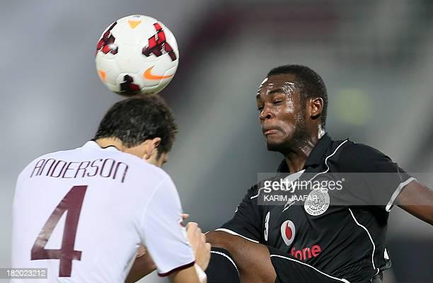 Eljaish SC Brazilian defender Anderson Vieira Martins challenges AlSadd's Abdul Karim Hassan during their Qatar Stars League football match in Doha...