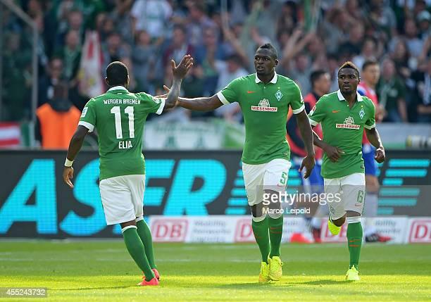 Eljero Elia, Assani Lukimya-Mulongoti and Cedrick Makiadi of SV Werder Bremen celebrate after scoring the 2:1 during the Bundesliga match between...