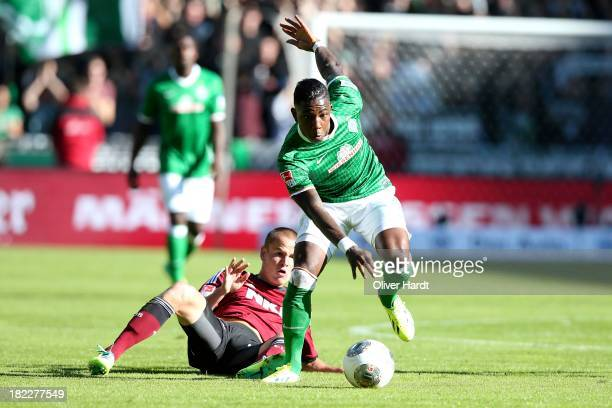 Eljero Elia of Bremen and Adam Hlousek of Nuernberg compete for the ball during the First Bundesliga match between SV Werder Bremen and 1FC Nuernberg...