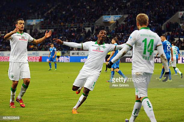 Eljero Elia of Bremen celebrates his team's second goal with team mates Aaron Hunt and Franco di Santo during the Bundesliga match between 1899...
