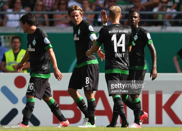 Eljero Elia of Bremen celebrates with his team mates after scoring his team's first goal during the DFB Cup first round match between Preussen...