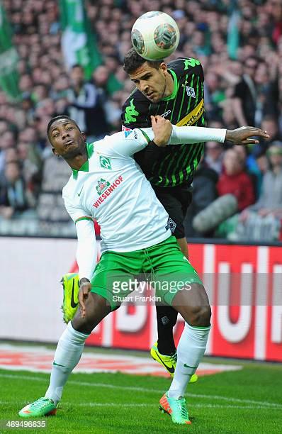 Eljero Elia of Bremen is challenged by Alvaro Dominguez Soto of Gladbach during the Bundesliga match between Werder Bremen and Borussia...