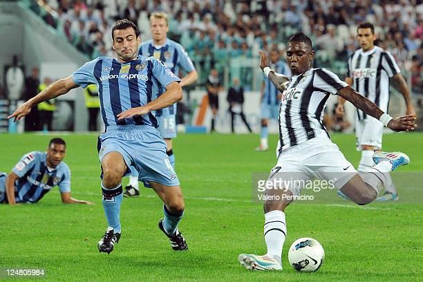 Eljero Elia of FC Juventus prepares to shoot at goal as he is closed down by Mike Edwards of Notts County during the pre season friendly match...
