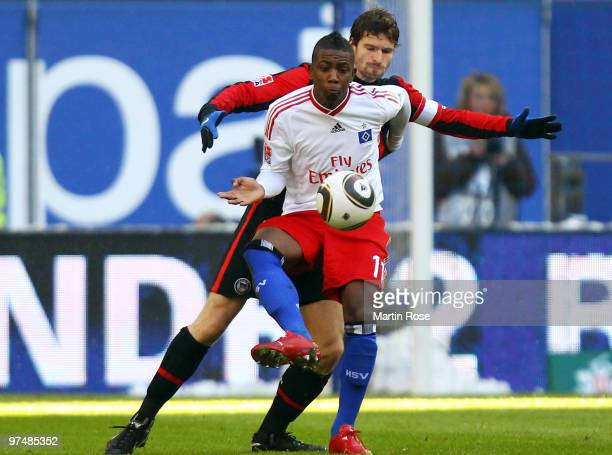 Eljero Elia of Hamburg and Arne Friedrich of Berlin compete for the ball during the Bundesliga match between Hamburger SV and Hertha BSC Berlin at...