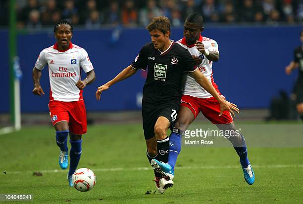 Eljero Elia of Hamburg and Clemens Walch of Kaiserslautern compete for the ball during the Bundesliga match between Hamburger SV and 1 FC...