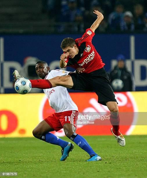 Eljero Elia of Hamburg and Daniel Schwaab of Leverkusen battle for the ball during the Bundesliga match between Hamburger SV and Bayer Leverkusen at...