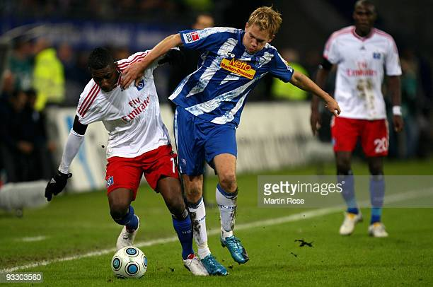 Eljero Elia of Hamburg and Dennis Grote of Bochum battle for the ball during the Bundesliga match between Hamburger SV and VfL Bochum at the HSH...