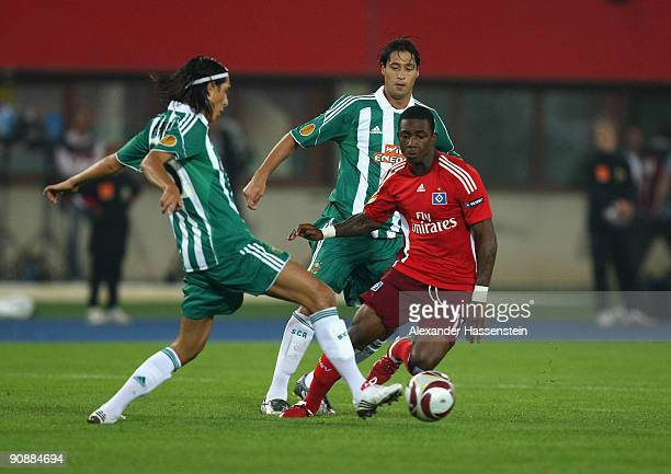 Eljero Elia of Hamburg battles for the ball with Yasin Pehlivan of Vienna and his team mate Branko Boskovic during the Europa League match between SK...