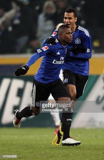 Eljero Elia of Hamburg celebrates the first goal with Eric Maxim ChoupoMoting of Hamburg during the Bundesliga match between Borussia...