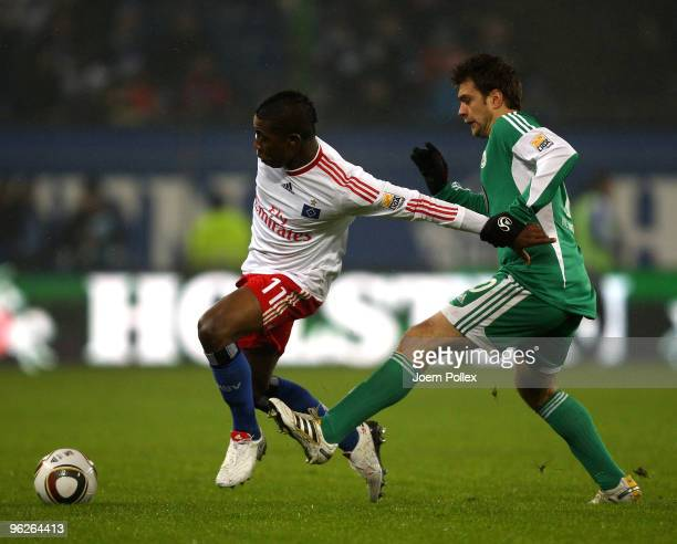 Eljero Elia of Hamburg is tackled by Zvjezdan Misimovic of Wolfsburg during the Bundesliga match between Hamburger SV and VfL Wolfsburg at HSH...