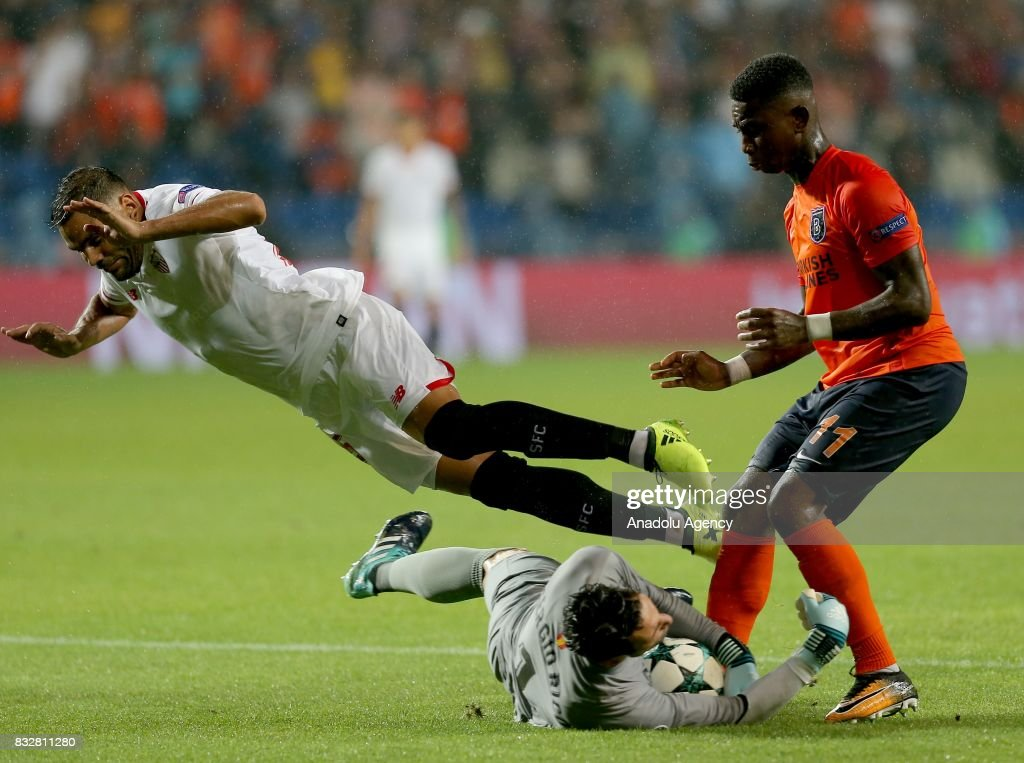 Eljero Elia (R) of Medipol Basaksehir in action against Gabriel Mercado (L) and Sergio Rico (on the floor) of Sevilla FC during the UEFA Champions League play-off match between Medipol Basaksehir and Sevilla FC at Basaksehir Fatih Terim Stadium in Istanbul, Turkey on August 16, 2017.