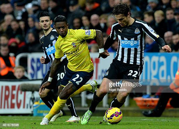 Eljero Elia of Southampton battles for the ball with Daryl Janmaat of Newcastle United during the Barclays Premier League match between Newcastle...