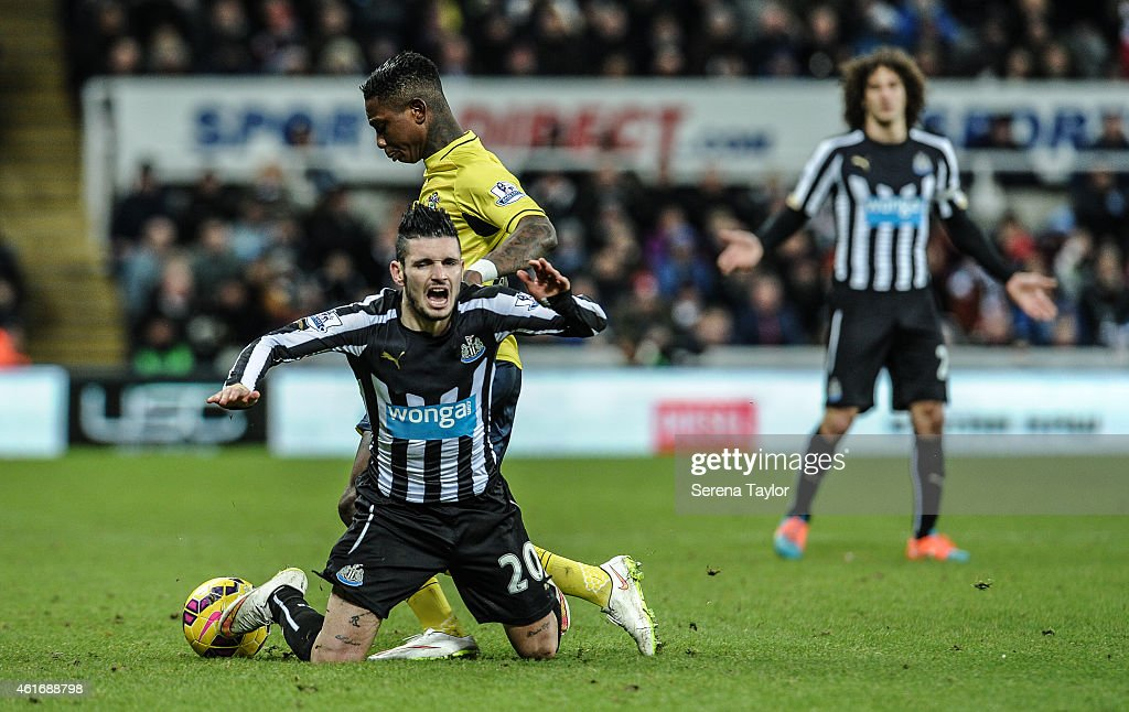Eljero Elia of Southampton pushes over Remy Cabella of Newcastle to win the ball during the Barclays Premier League match between Newcastle United and Southampton at St.James' Park on January 17, 2015, in Newcastle upon Tyne, England.