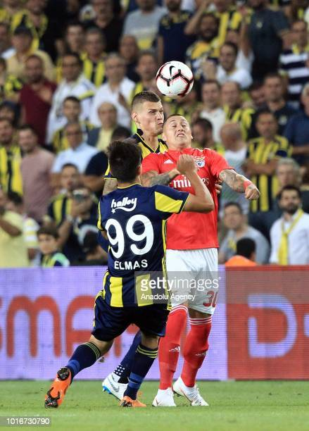 Eljif Elmas and Martin Skrtel of Fenerbahce in action against Nicolas Castillo of Benfica during UEFA Champions League third qualifying round's...