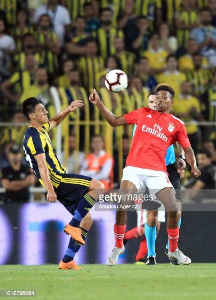 Eljif Elmas of Fenerbahce vies with Gedson Fernandes of Benfica during UEFA Champions League third qualifying round's second leg match between...