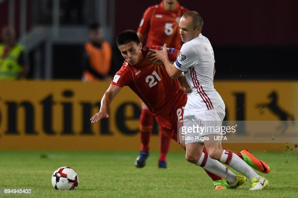 Eljif Elmas of FYR Macedonia and Andres Iniesta of Spain compete for the ball during the FIFA 2018 World Cup Qualifier between FYR Macedonia and...
