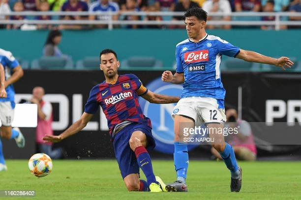 Eljif Elmas of Naoli fights for the ball with Sergio Busquets of Barcelona during the preseason friendly match between FC Barcelona and SSC Napoli at...