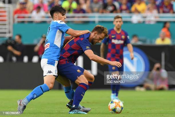 Eljif Elmas of Napoli fights for the ball with Ivan Rakitic of Barcelona during the preseason friendly match between FC Barcelona and SSC Napoli at...
