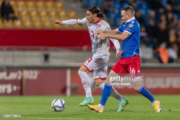 Eljif Elmas of North Macedonia and Fabio Wolfinger of Liechtenstein battle for the ball during the 2022 FIFA World Cup Qualifier match between...