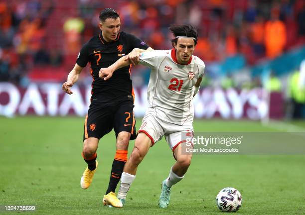 Eljif Elmas of North Macedonia is challenged by Steven Berghuis of Netherlands during the UEFA Euro 2020 Championship Group C match between North...
