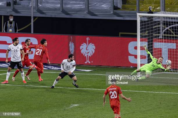 Eljif Elmas of North Macedonia scores his team's second goal past goalkeeper Marc-Andre ter Stegen of Germany during the FIFA World Cup 2022 Qatar...