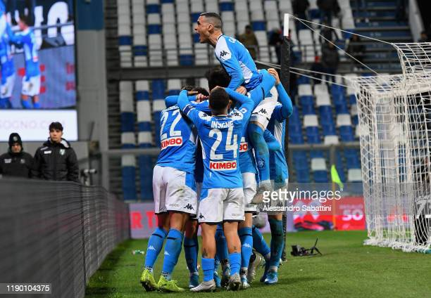 Eljif Elmas of SSC Napoli celebrates with his team-mates after scoring their second goal during the Serie A match between US Sassuolo and SSC Napoli...