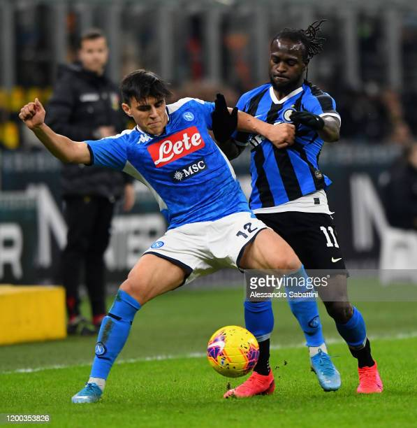 Eljif Elmas of SSC Napoli competes for the ball with Victor Moses of FC Internazionale during the Coppa Italia Semi Final match between FC...