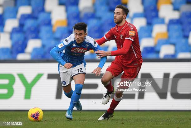 Eljif Elmas of SSC Napoli vies with Filippo Sgarbi of Perugia during the Coppa Italia match between SSC Napoli and Perugia on January 14 2020 in...