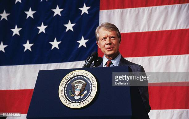President Carter speaks to the citizens of Elk City fulfilling a campaign pledge to return after his election Speaking before a huge American flag...