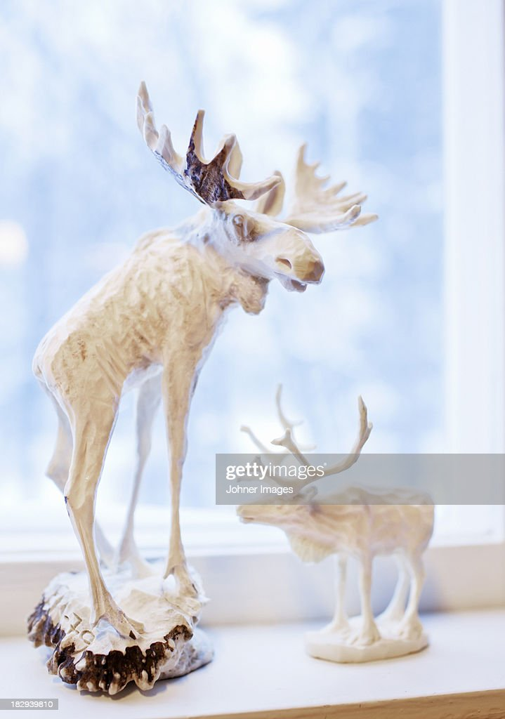 Elk statues on window sill closeup stock photo getty images elk statues on window sill close up stock photo publicscrutiny Image collections