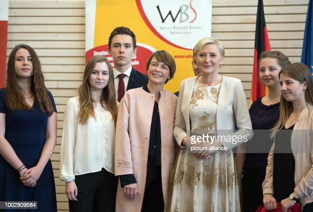 Elke Budenbender wife of German President Steinmeier and Agata KornhauserDuda wife of Polish President Duda standing next to each other during a...