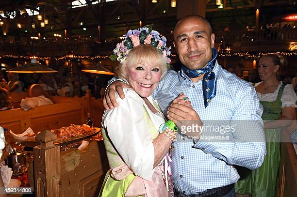 Elke Sommer and Arthur Abraham attend the Sauerland Wiesn at Weinzelt during Oktoberfest at Theresienwiese on September 29, 2014 in Munich, Germany.