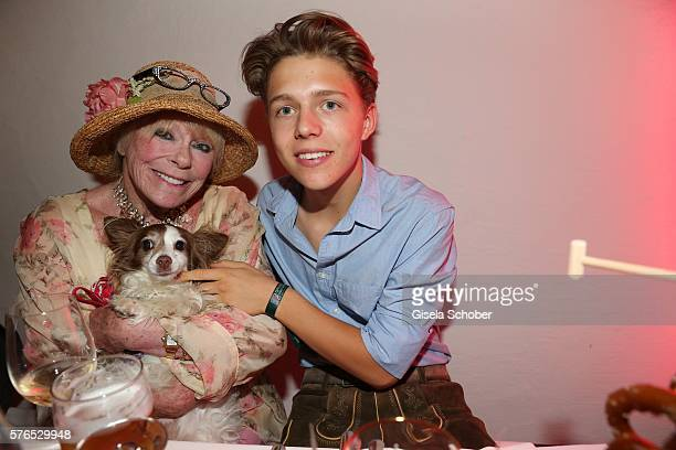 Elke Sommer and her dog Smiley and Joel Maximilian Beckenbauer son of Franz Beckenbauer during a bavarian evening ahead of the Kaiser Cup 2016 on...