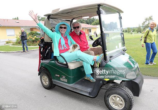 Elke Sommer and her husband Wolf Walther in a golf car during the Kaiser Cup 2016 on July 16 2016 in Bad Griesbach near Passau Germany