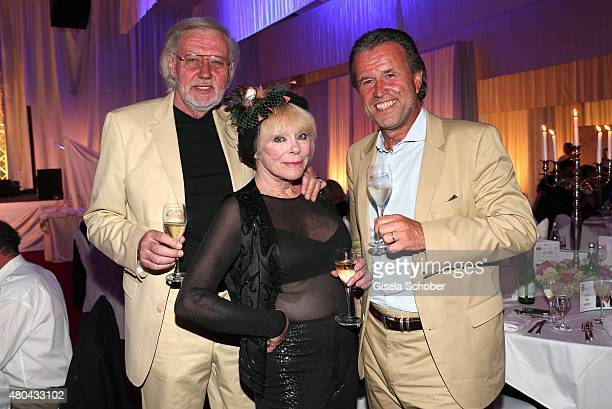 Elke Sommer and her husband Wolf Walther Thomas Schreiner CEO Laurent Perrier Champagner during the Kaiser Cup 2015 golfcup and gala on July 11 2015...