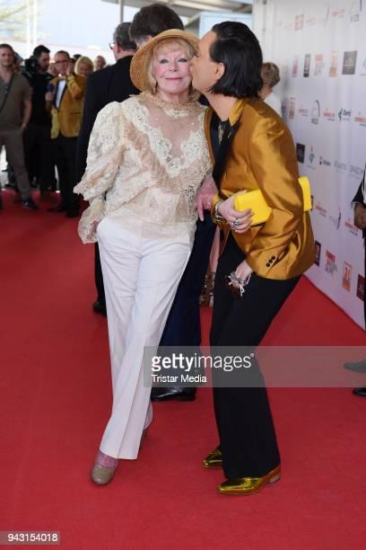 Elke Sommer and Julian F M Stoeckel attend the 'Goldene Sonne 2018' Award by SonnenklarTV on April 7 2018 in Kalkar Germany