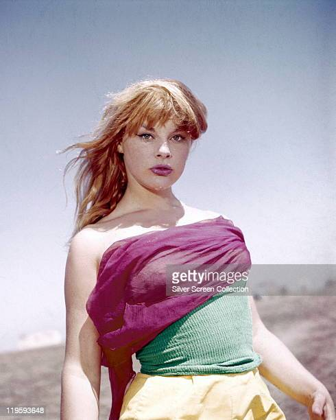 Elke Sommer German actress wearing a pink green and yellow outfit with the sea in the background circa 1965