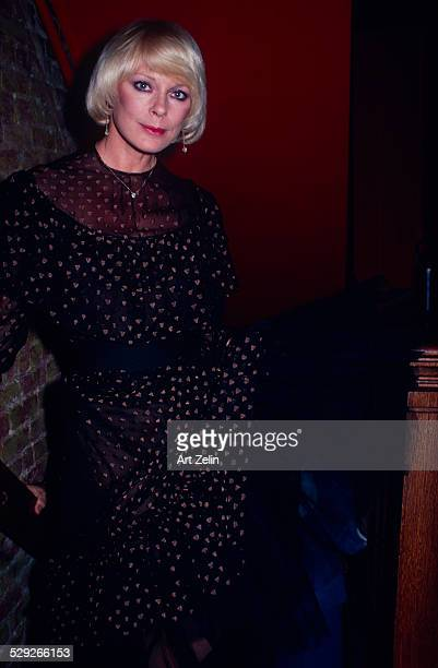Elke Sommer in a formal dress on a stairway; circa 1970; New York.