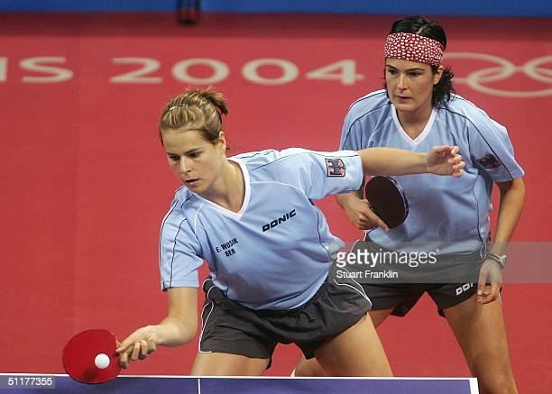 Elke Wosik and Nicole Struse of Germany play against Karen Li and Chunli Li of New Zealand during the women's doubles table tennis match on August...