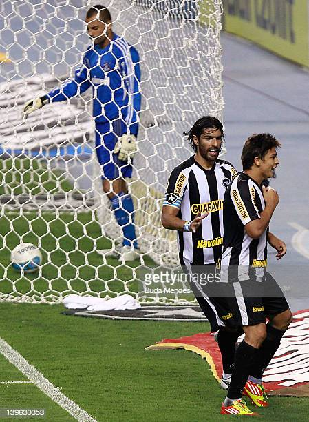 Elkeson and Loco Abreu of Botafogo celebrate a scored goal during the semifinal match as part of Rio State Championship 2012 at Engenhao Stadium on...