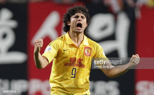 Elkeson De Oliveira Cardoso of Guangzhou Evergrande celebrates after scoring their first goal during the AFC Champions League Final 1st leg match...