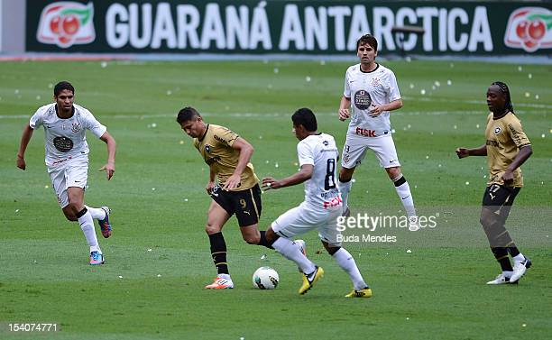 Elkeson of Botafogo fights for the ball with Wallace and Paulinho of Corinthians during a match between Botafogo and Corinthians as part of the...